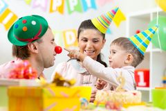 Parents have fun celebrating birthday of his son Royalty Free Stock Photo