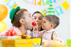 Parents have fun celebrating birthday of kid son Royalty Free Stock Photos