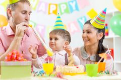 Parents have fun time celebrating birthday of kid Stock Photos