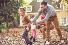 Parents have play with children. Autumn season. Stock Photography