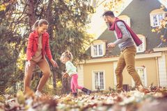 Parents have play with daughter outside. On the move. Royalty Free Stock Photo