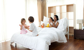 Parents having breakfast and children playing Royalty Free Stock Image