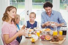 Parents having breakfast with children Stock Photography