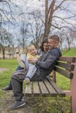 Parents having fun with their child in park, in nature stock images