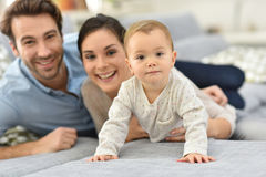 Parents having good time together with their baby girl Stock Photos