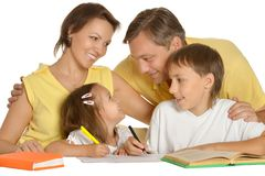 Parents help children with homework Stock Images