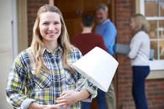 Parents Helping Adult Daughter To Move Into Home Stock Image