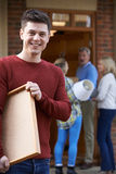 Parents Helping Adult Son To Move Into Home Royalty Free Stock Photos