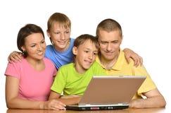 Parents helping boys with homework Stock Photos