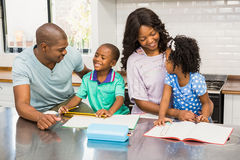 Parents helping children doing homework. In the kitchen Royalty Free Stock Photography