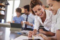 Parents Helping Children With Homework Before Going To Work royalty free stock photo