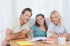 Parents helping her daughter to do her homework Royalty Free Stock Image