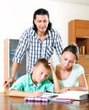 Parents helping with homework Stock Photo