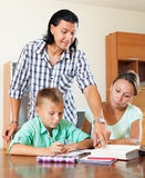 Parents helping with homework Royalty Free Stock Image