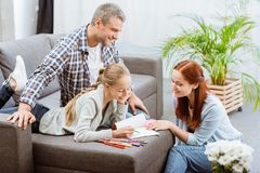 Parents helping teenager with homework Royalty Free Stock Images