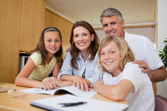 Parents helping their children with homework Royalty Free Stock Image