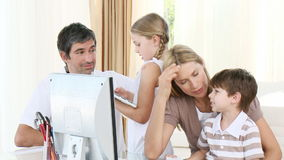 Parents helping their children to do homework stock video footage