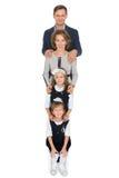 Parents heureux avec des enfants Photographie stock
