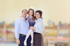 Parents heureux avec une petite fille Photographie stock libre de droits