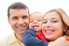 Parents hold child on hands Royalty Free Stock Photo