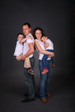 Parents hold children on hands Royalty Free Stock Image