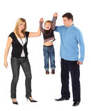 Parents hold son for hands, full body Stock Photos
