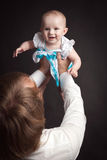 Parents hold their baby studio Royalty Free Stock Photo