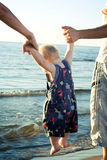 Parents holding baby. Stock Images