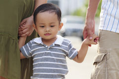 Parents holding hand of his son Royalty Free Stock Image