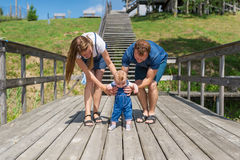 Parents holding their little son making first steps Royalty Free Stock Photos
