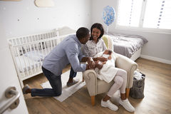 Parents Home from Hospital With Newborn Baby In Nursery Royalty Free Stock Image