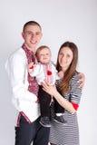 Parents hug child Stock Photos
