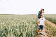 parents hugging and happy son looking at camera on path royalty free stock photos