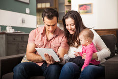 Parents introducing their baby to technology Stock Image