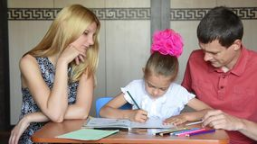 Parents are involved in the lessons with her daughter schoolgirl stock video footage