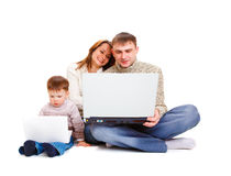 Parents and kid with laptop