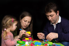 Parents and kids art and crafts Stock Photos