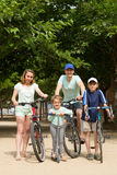 Parents and kids with bicycles Royalty Free Stock Image