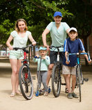 Parents and kids with bicycles Stock Photography