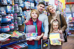 Parents and kids choosing writing materials Royalty Free Stock Photo