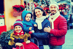 Parents with kids choosing X-mas decorations in market Stock Images