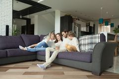 Parents with kids having fun with laptop in living room stock images