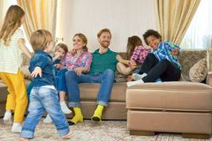 Parents and kids indoors. Royalty Free Stock Photo
