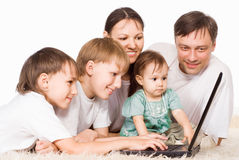 Parents and kids with laptop Stock Images