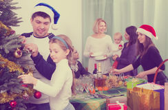 Parents with kids preparing for Christmas. Parents and happy kids with grandparents preparing for Christmas celebration stock photography