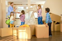 Parents and kids, relocation. Stock Photography