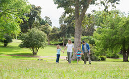 Parents and kids walking in park Royalty Free Stock Images