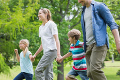 Parents and kids walking in park Stock Image