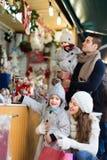 Parents with kids at  X-mas market Stock Photos