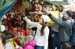 Parents with kids at X-mas market Stock Image